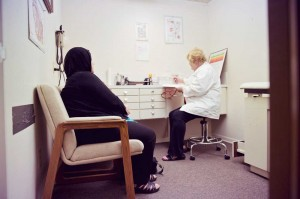 Nurse practitioner Sandra Pinkston talks with a patient at the Al-Shifa clinic.