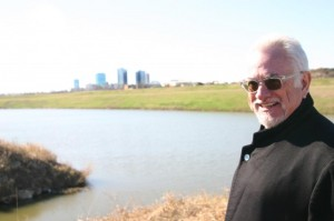 ARCHITECT KEN SCHAUMBURG AT THE SITE OF THE PLANNED APARTMENTS (photo by Jeff Prince).