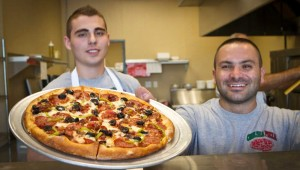 Chelsea owner Kevin Bellomo and co-worker Tim Jonuzi have got your pie right 'eeere! Tony Robles