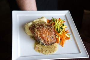 Chef Nelson serves up some salmon at his new joint. Brian Hutson