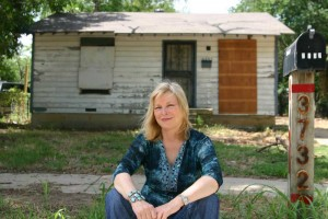 "Clark, in front of one of her childhood homes: ""We were living on beans."" Jeff Prince"
