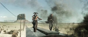 Johnny Depp and Armie Hammer try to catch up with the bad guys' train car in The Lone Ranger.