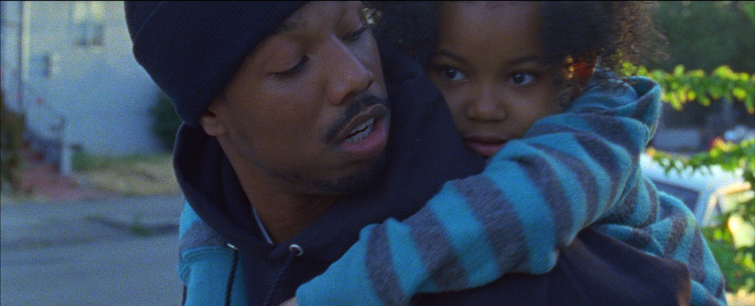 Michael B. Jordan gives Ariana Neal a piggyback ride in Fruitvale Station.