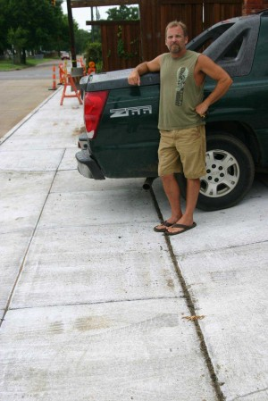 Brian Bentley's vehicle no longer fits legally in the driveway after the city poured a sidewalk. Jeff Prince