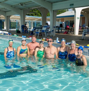 Cannell (third from right) got her swim team involved in water safety education. Left to right: Terry Woods, Elaina Rowe, Coach Chuck Burr, Sarah Mountjoy, Roger Yates, Cannell, Julie Jackson and Michelle Brannan. Brian Hutson