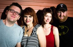 Kevin Buchanan, Steph Buchanan, Mandy Hand, and Aubrey Savage play cheerful, upbeat songs with smart, long sentences.