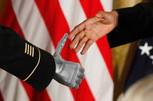 President Obama shakes the prosthetic hand of an Army Ranger. AP Photo/Charles Dharapak