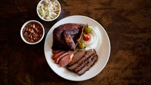 Chicken, sausage, and sliced brisket make a fine plate at the Back Forty Smokehouse. Adrien P. Maroney