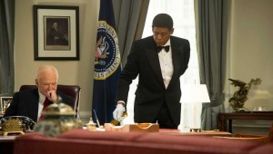 Forest Whitaker tidies up Robin Williams' desk in the Oval Office in Lee Daniels' The Butler.