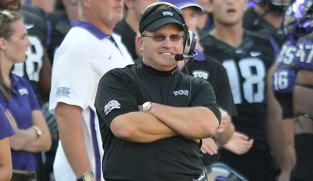 Coach Gary Patterson leads TCU out at Cowboys Stadium, Sat.