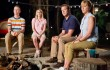 Will Poulter, Emma Roberts, Jason Sudeikis, and Jennifer Aniston gather round the campfire in We're the Millers.