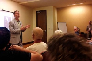 """Jackson, speaking at a convention in San Antonio: """"We have stigmatized persons who have mental illness, and we have separated it from biological illness."""" Courtesy Greg Harman"""