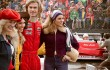 Chris Hemsworth hangs out with Formula One groupies while Daniel Brühl looks on in Rush.