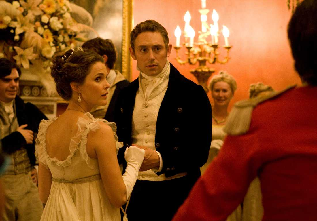 Keri Russell and JJ Feild dance a minuet in a drawing room that's not in 19th-century England in