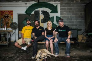 The folks at PalletSmart make fine furniture from wooden shipping pallets. Even Jake, the shop dog, is recycled (from the shelter). Brian Hutson