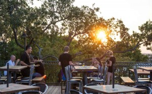 A big live oak shades the rooftop patio at The Live Oak Music Hall & Lounge. Brian Hutson
