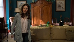 Who's on the sofa behind Rose Byrne in Insidious: Chapter 2?