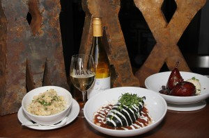 A bottle of vino is the perfect acompaniment  to Max's (from left to right) mac 'n' cheese, the chile relleno, and Spanish wine-soaked pears. Lee Chastain