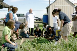 Students at T.A. Sims Elementary School tend their garden. Lee Chastain