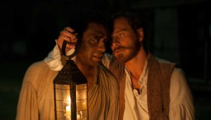 Chiwetel Ejiofor stands up under interrogation by Michael Fassbender in 12 Years a Slave.