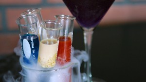 The Lab Rack, a flight of shots, is served in a smoking beaker.