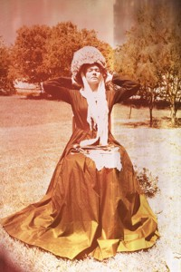 Amie Carson, as Nightingale, models a sponge cap, lace scarf, and Victorian dress. Courtesy Tom Sale