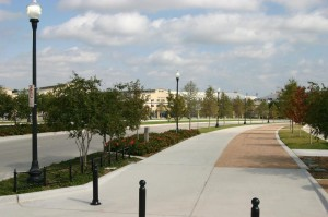 Trail Drive sports extra-wide sidewalks with an accompanying horse path, ornate light poles, and extensive landscaping.