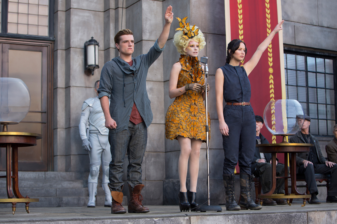 Josh Hutcherson and Jennifer Lawrence flank Elizabeth Banks and say goodbye to District 12 in The Hunger Games: Catching Fire.