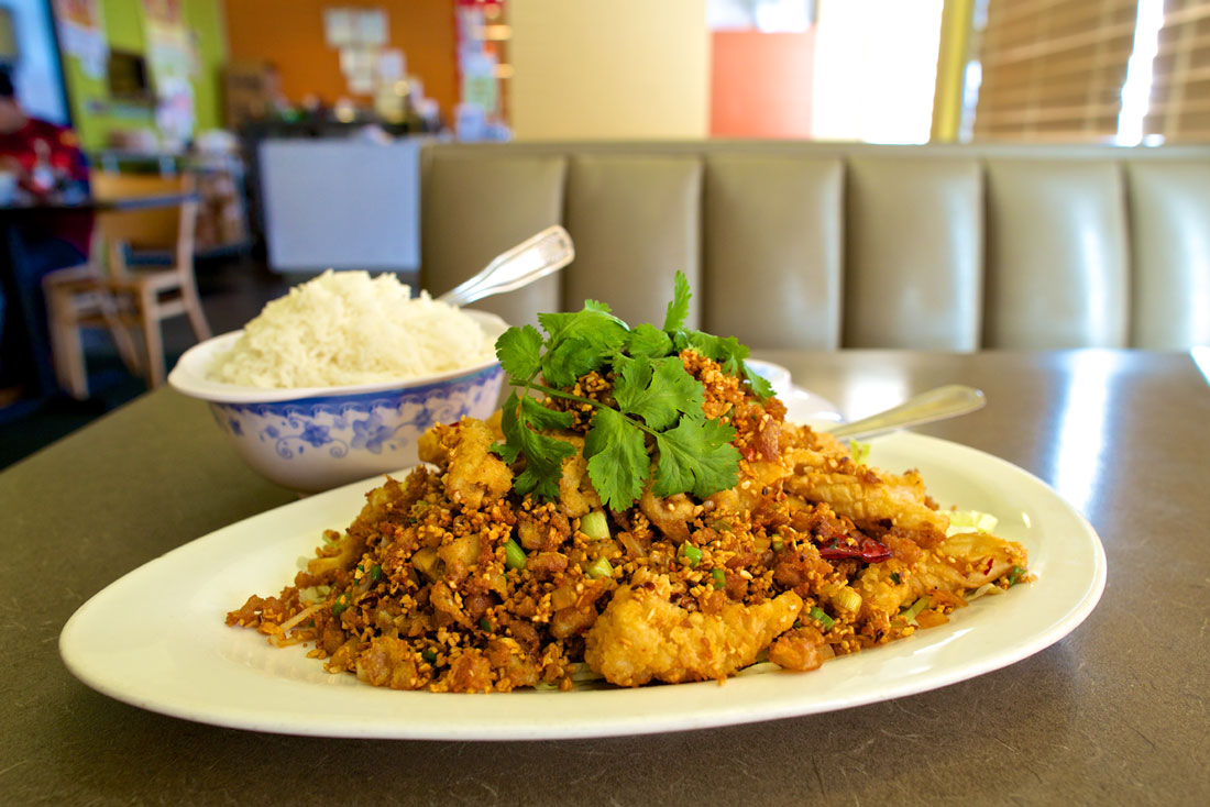 Like everything at First Chinese BBQ, the Hong Kong-style fried squid with rice is hyper-traditional. Vishal Malhotra