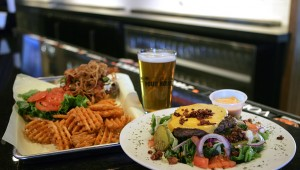The 7th Street Burger and Eric's Cheeseburger Salad are just a couple of The Pour House's funky new offerings. Lee Chastain