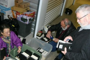 Peggy Bott Kirby and Bob Bourland get down on the floor to organize tapes while Bruce Balentine examines labels. Jeff Prince