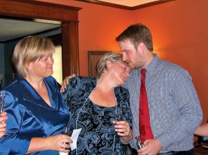 David Allison, right, gives his mom a hug. He considers November, left, his second mom. Sara Hickman-Himes