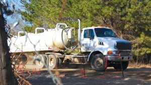 Tanker truck traffic around injection wells is just one of the reasons they're unpopular with neighbors. Gayle Reaves