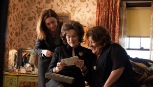 Julianne Nicholson, Meryl Streep, and Margo Martindale consult their family history in August: Osage County.