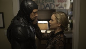 Joel Kinnaman has mixed emotions on his homecoming to Abbie Cornish in RoboCop.