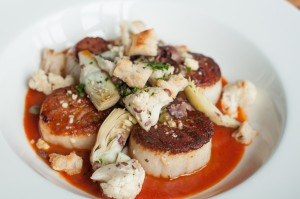 As these seared scallops prove, the food is fresh and inventive at Clay Pigeon. Brian Hutson
