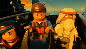 The fellowship of the brick: Wyldstyle, Emmet, and Vitruvius take a ride in the Batjet in The Lego Movie.