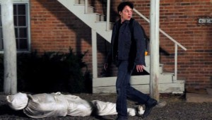 Anton Yelchin tries to get rid of a package that someone else left at his apartment in Odd Thomas.