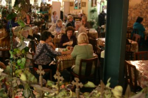 Diners enjoy quiche and key lime pie at The Secret Garden restaurant.