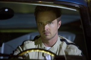 Aaron Paul focuses behind the wheel in Need for Speed.