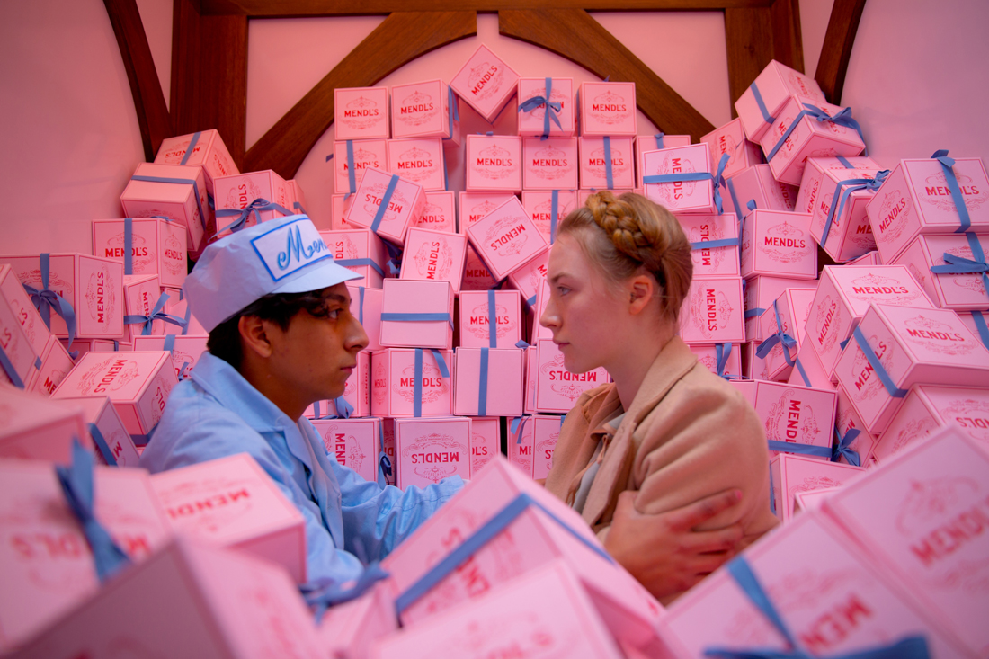 Surrounded by pastry boxes, Tony Revolori and Saoirse Ronan fall in love at The Grand Budapest Hotel.