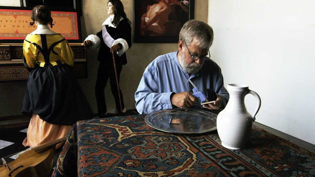"""With mannequins in the background, Tim Jenison preps his life-size replica of Vermeer's """"The Music Lesson"""" in Tim's Vermeer."""