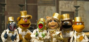 Gonzo, Fozzie, Kermit, Miss Piggy, Rowlf, and Scooter kick up their heels for a sequel in Muppets Most Wanted.