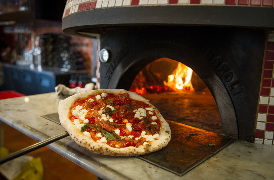 The pies come straight from Cane Rosso's 900-degree brick oven. Brian Hutson