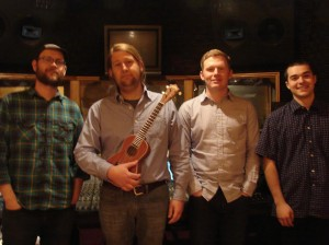With producer Britt Robisheaux (left), Lazy Summer — (from left to right) Jeremiah Kirby, Justin Weisenborn, and Deryck Barrera — are about to release their second album.