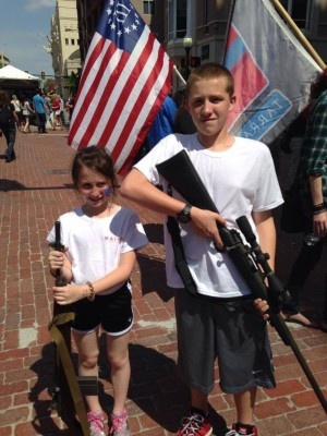 "THIS PICTURE OF ""OPEN CARRY TEXAS"" CHILDREN CARRYING GUNS AT MAIN STREET ARTS FESTIVAL WAS PUBLISHED ON THE MERICANS AGAINST THE TEA PARTY WEB SITE."