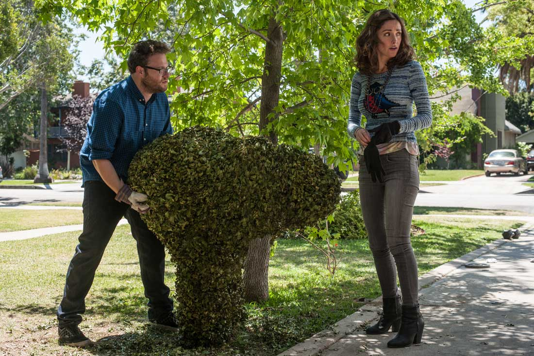 Seth Rogen and Rose Byrne find their shrubbery carved into a rude shape by the frat next door in Neighbors.