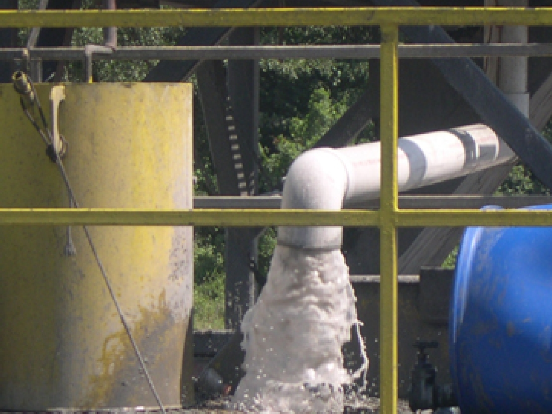 Flowback water flows fiercely at a gas rig near Everman.