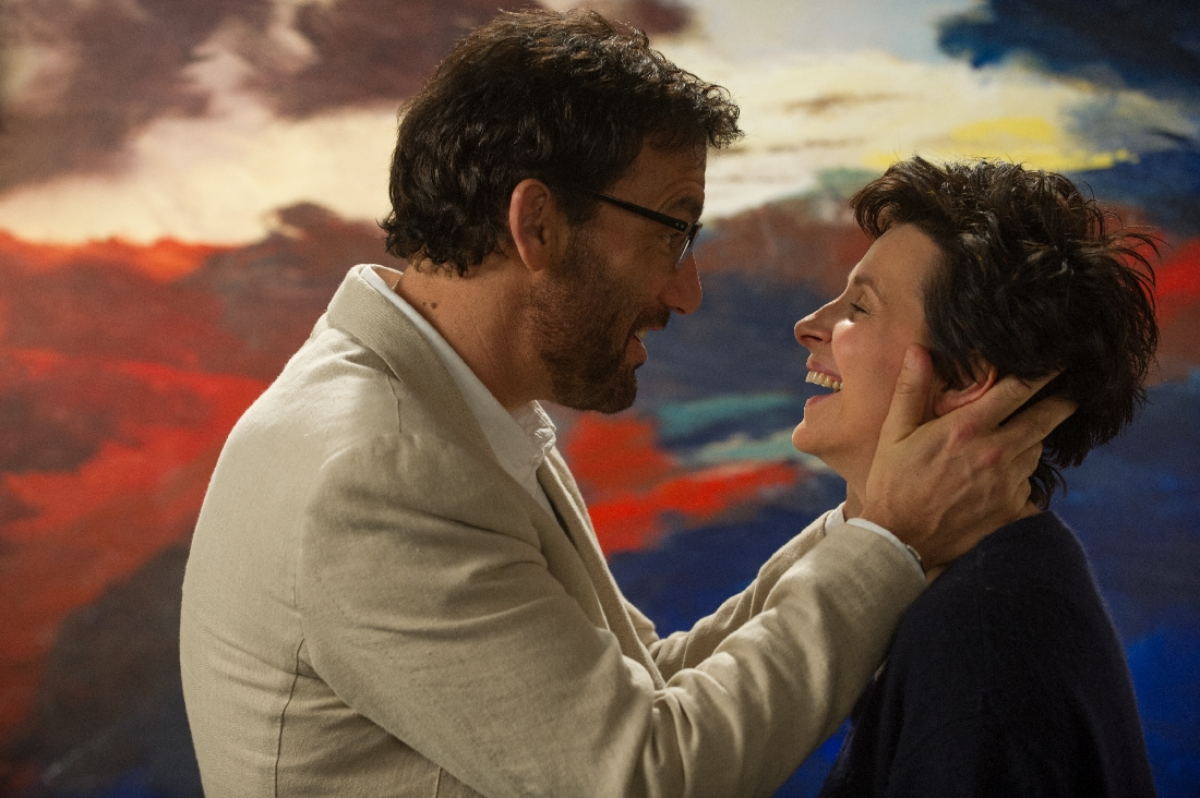 Clive Owen and Juliette Binoche share a laugh in front of one of her paintings in Words and Pictures.