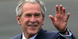 U.S. President George W. Bush waves upon arrival at RAF Aldg